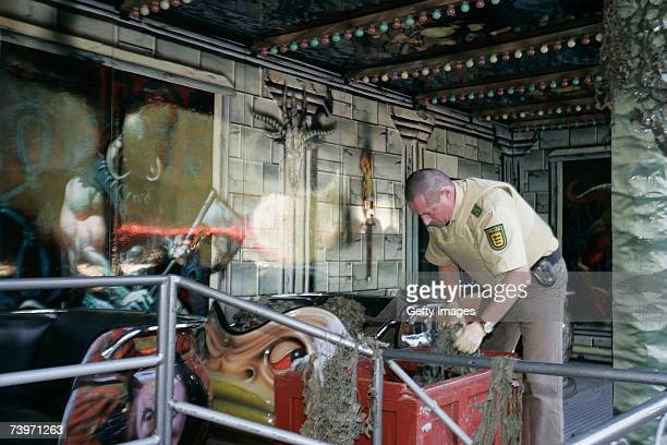 Policeman searches a fun fair ride following the shooting of two police officers at the Theresienwiese on April 25 2007 in Heilbronn Germany...
