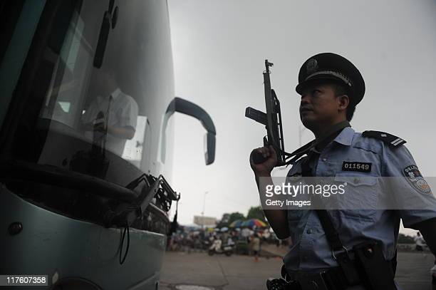 Policeman searches for a suspect at a coach station on June 28, 2011 in Changsha, Hunan Province of China. A 48-year-old businessman was reportedly...