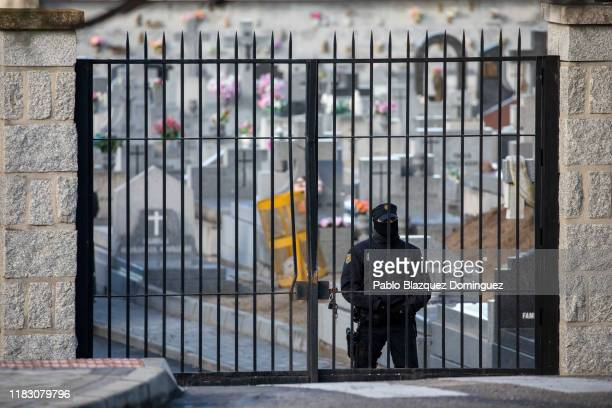A policeman secures a gate of Mingorrubio cemetery during Franco's exhumation on October 24 2019 in El Pardo neighborhood in Madrid Spain Francisco...