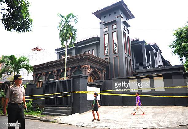 A policeman secures the residence of Indonesian rock musician Ahmad Dhani who is known for his songs protesting against religious extremism in...