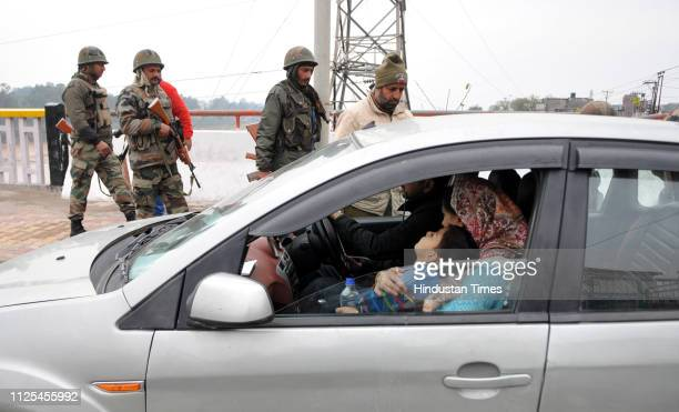 A policeman seen checking a vehicle during the curfew at a checkpoint on February 17 2019 in Jammu India Curfew continued without any relaxation in...