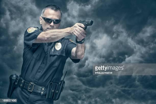 Policeman shooting his pistol