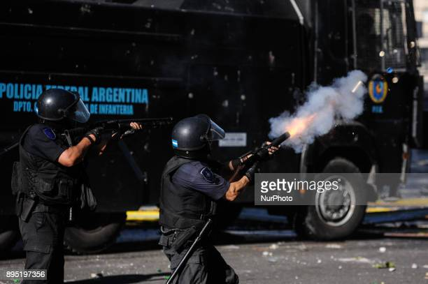 A policeman shoots during a protest against the pension reform on December 2017 in Buenos Aires Argentina Argentina's lower house resumed a debate on...
