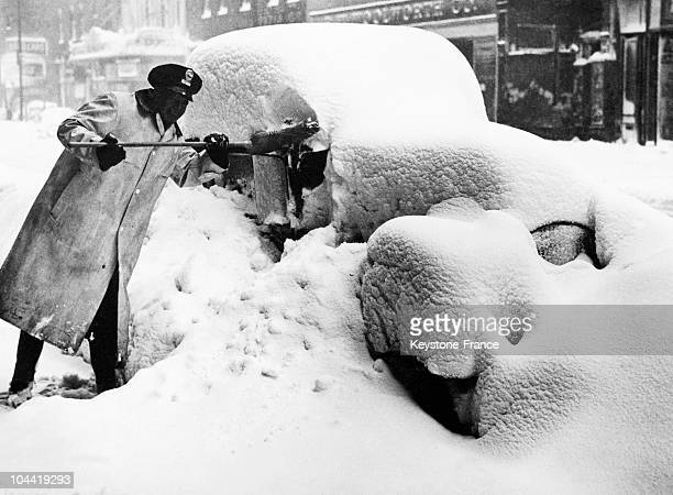 Policeman Shovels Snow From His Car After A Snowstorm Hit The City Of Chicago Usa Around 1938