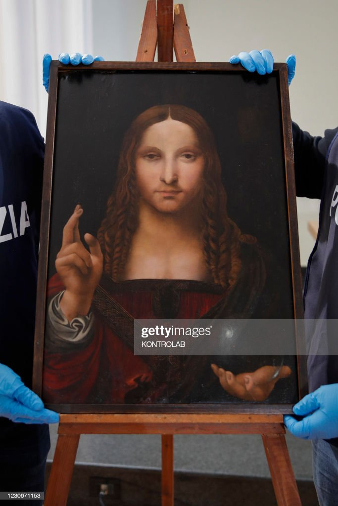 """Policeman show the """"Salvator Mundi"""", a painting from the... : News Photo"""