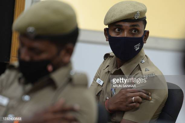 Policeman sits inside an observation room after receiving a Covishield Covid-19 coronavirus vaccine, at a vaccination camp, in Chennai on April 19,...