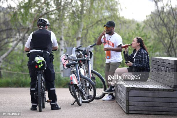 Policeman speaks to people who are ignoring the social distancing laws at Queen Elizabeth Olympic Park on April 11, 2020 in London, England. Public...