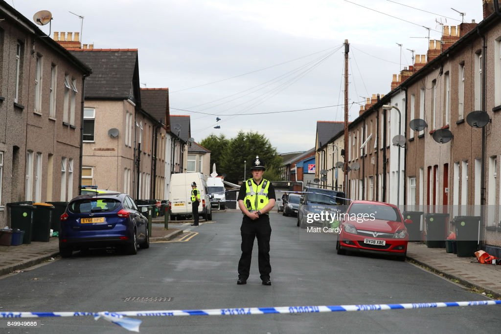 A policeman stands about a cordon on September 20, 2017 in Newport, Wales. A 48-year-old man and a 30-year-old man have been detained under the Terrorism Act after a search at an address in Newport. This morning's arrests bring the total number held to five.