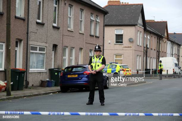 A policeman stands about a cordon on September 20 2017 in Newport Wales A 48yearold man and a 30yearold man have been detained under the Terrorism...
