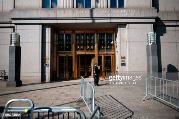 A policeman stands at the courthouse ahead of a bail hearing in US financier Jeffrey Epstein's sex trafficking case on July 15 2019 in New York City...