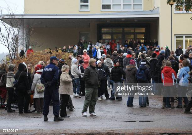 A policeman stands at the entrance of Perttu high school 12 November 2007 in Tuusula southern Finland after eight people including five teenage boys...