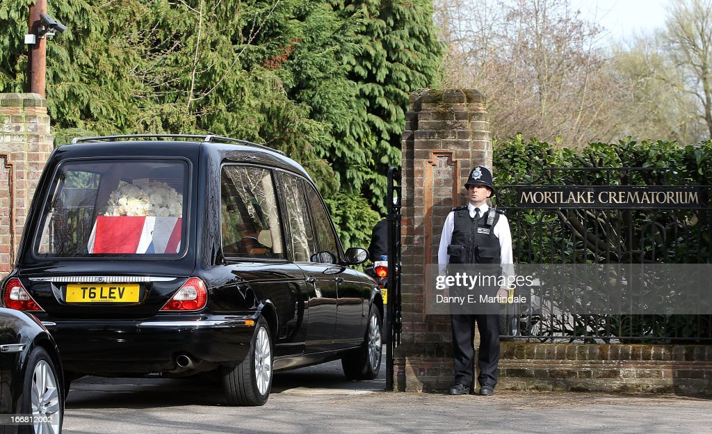 A policeman stands guard as Former British Prime Minister Baroness Thatcher's coffin arrives in the hearse at Mortlake Crematorium where her private cremation will take place on April 17, 2013 in London, England. Dignitaries from around the world today join Queen Elizabeth II and Prince Philip, Duke of Edinburgh as the United Kingdom pays tribute to former Prime Minister Baroness Thatcher during a Ceremonial funeral with military honours at St Paul's Cathedral. Lady Thatcher, who died last week, was the first British female Prime Minister and served from 1979 to 1990.