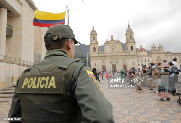 A policeman stands guard at the Bolivar square in Bogota on August 25 on the eve of the anticorruption consultation Colombia holds a popular...