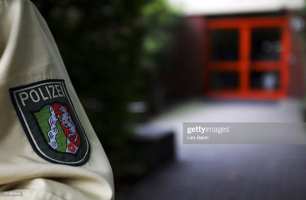 A policeman stands guard at the elementary school in Duisburg's Dislichstrasse on September 01, 2006, Duisburg-Meiderich, Germany. On the evening of August 31, 2006 a nine year old schoolgirl was wounded as she played in the schoolyard with other pupils, children heard two shoots fired. The police are tracing a suspect, a former teacher living opposite the school.