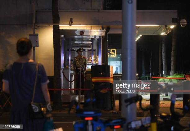 Policeman stands guard at the entrance to the US consulate in Chengdu, southwestern China's Sichuan province, on July 24, 2020. - China on July 24...
