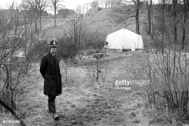 A policeman stands guard at the tent which covers the manhole cover under which the body of kidnapped heiress Lesley Whittle was found