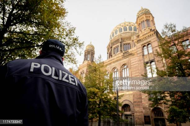 Policeman stands guard in front of the Neue Synagoge in Berlin, Germany, as increased security measures are taken following a shooting in Dresden,...