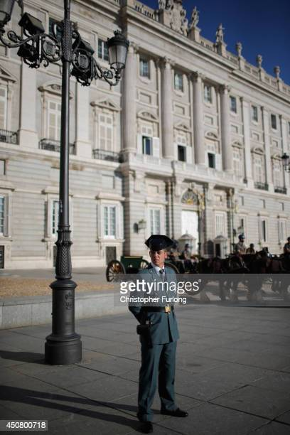 A policeman stands guard in front of the Royal Palace as final preparations for tomorrows coronation of Prince Felipe are completed on June 18 2014...