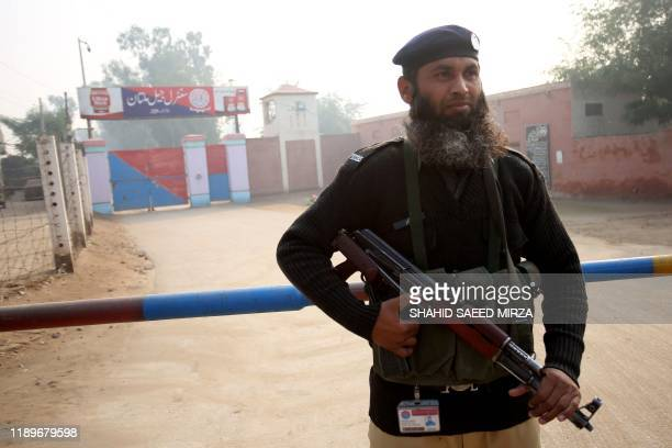 Policeman stands guard outside the central jail, as the court delivered the verdict on a blasphemy case, in Multan on December 21, 2019. - A...