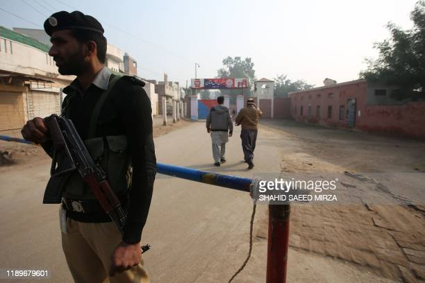 A policeman stands guard outside the central jail as the court delivered the verdict on a blasphemy case in Multan on December 21 2019 A Pakistani...
