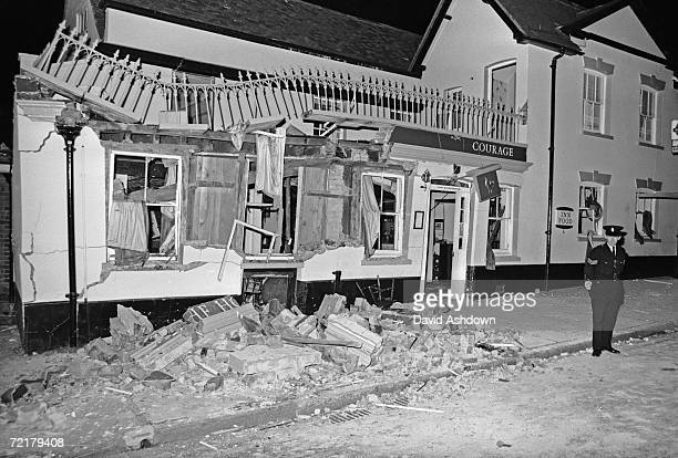 A policeman stands guard outside the Horse and Groom pub in Guildford Surrey wrecked after an IRA bomb explosion which killed five people and injured...