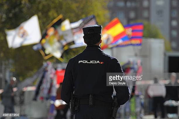 A policeman stands guard outside the Santiago Bernabeu stadium during tight security ahead of the La Liga match between Real Madrid and Barcelona at...