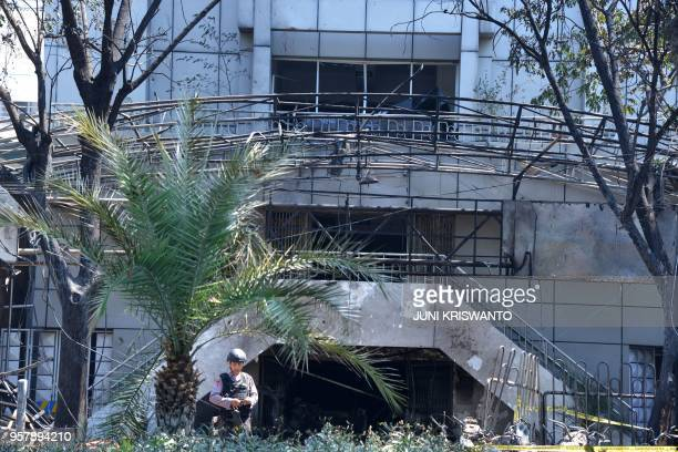 A policeman stands guard outside the Surabaya Centre Pentecostal Church in Surabaya East Java on May 13 2018 A series of blasts including a suicide...