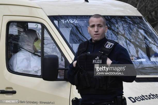 A policeman stands in front of a van of the German Red Cross carrying German citizens repatriated from the chinese city affected by the Corona virus...