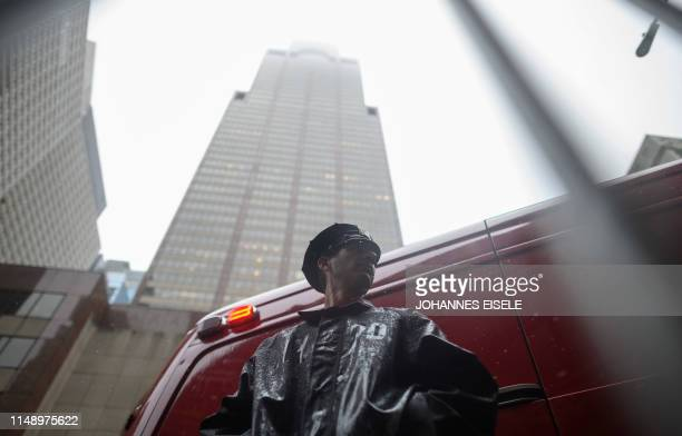 TOPSHOT A policeman stands in front of the building where a helicopter crashlanded on top in midtown Manhattan in New York on June 10 2019 The crash...