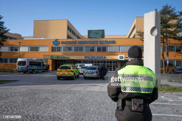 Policeman stands in front of the Faculty Hospital in Ostrava, eastern Czech Republic, after a gunman opened fire killing six people, on December 10,...