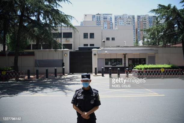 Policeman stands in front of the US Consulate in Chengdu, southwestern China's Sichuan province, on July 27, 2020. - Chinese authorities took over...