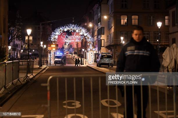 Policeman stands in the streets of Strasbourg eastern France after a shooting breakout on December 11 2018 At least two people have been killed and...