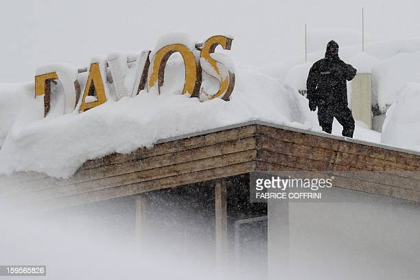 A policeman stands on the roof of a hotel next to the Congress Center hosting the World Economic Forum annual meeting in the Swiss resort of Davos on...