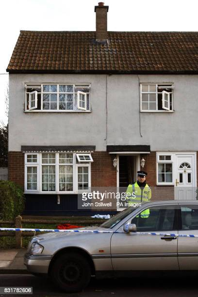 A policeman stands outside a property in Alderman Avenue Barking Essex where three people were found dead from a gas leak