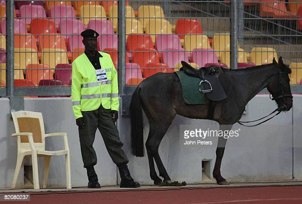 A policeman stands with his horse during the preseason friendly match between Manchester United and Portsmouth during their preseason tour to South...