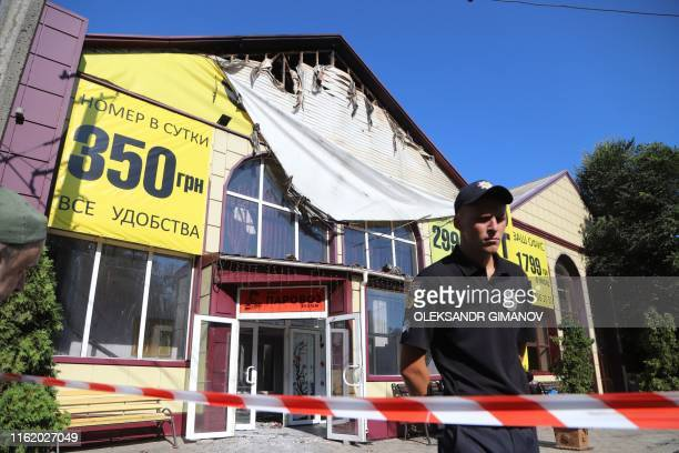Policeman stays in guard in front of the Tokyo Star hotel in Odessa, southern Ukraine, on August 17, 2019 after a fire broke out overnight. - Eight...