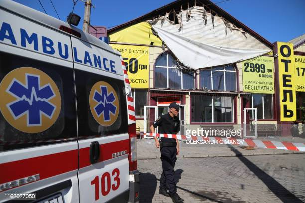 TOPSHOT A policeman stays in guard in front of the Tokyo Star hotel in Odessa southern Ukraine on August 17 2019 after a fire broke out overnight...