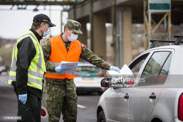 Policeman stops a truck at the Slovakian-Hungarian border, tightened border controls take place at the Slovenske Darmoty - Balassagyarmat border...
