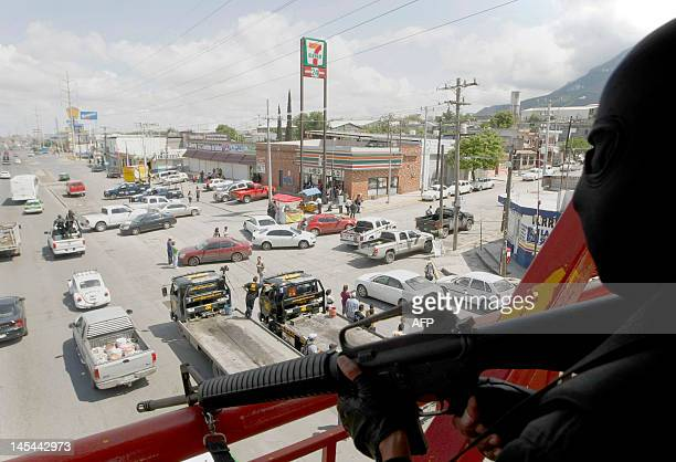 A policeman surveys the scene were eight bodies of taxi drivers were killed at the Costa Azul neighbordhood in Monterrey Mexico on April 10 1012 More...