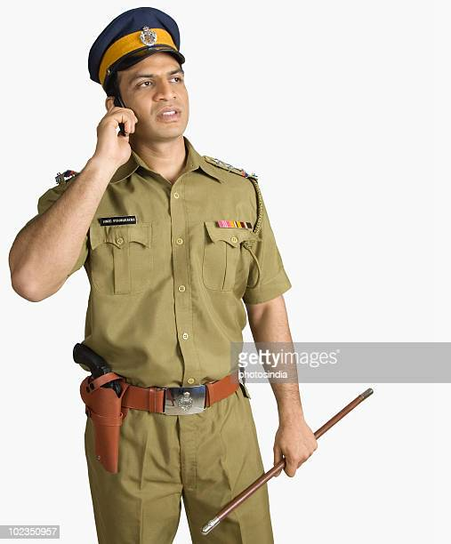 Policeman talking on a mobile phone