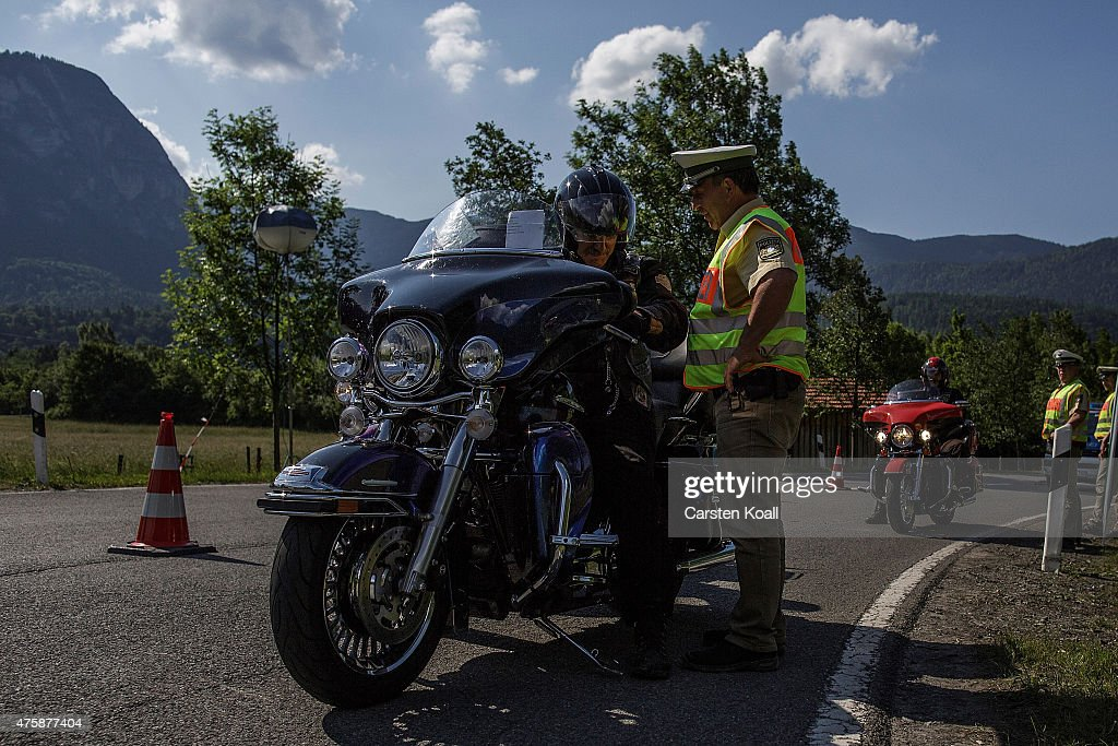 A policeman talks with a motorbike rider at a checkpoint ahead of the upcoming summit of G7 nation leaders on June 4, 2015 in Garmisch-Partenkirchen, Germany. G7 leaders will meet at nearby Schloss Elmau on June 7-8 and protesters are planning a variety of gatherings and demonstrations in coming days to voice their opposition.