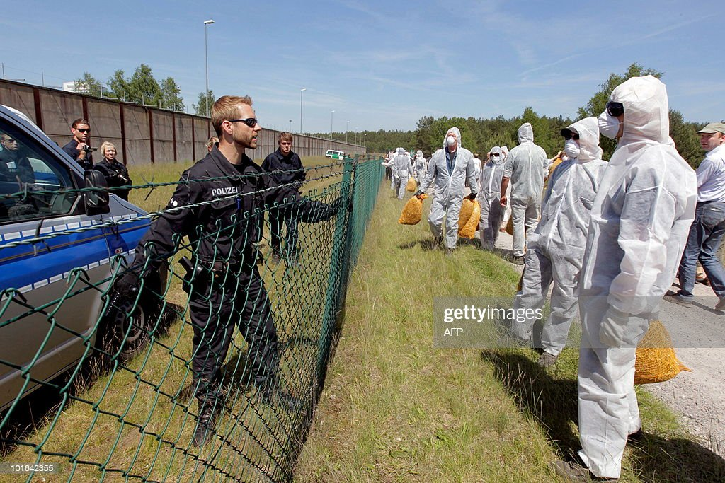 A policeman talks with anti-nuclear activists as they protest against an ultimate storage facility for nuclear waste in a salt deposit in Gorleben, western Germany, on June 5, 2010. Since more than 30 years, environmentalists protest against the storage which is already used as interim storage facility.
