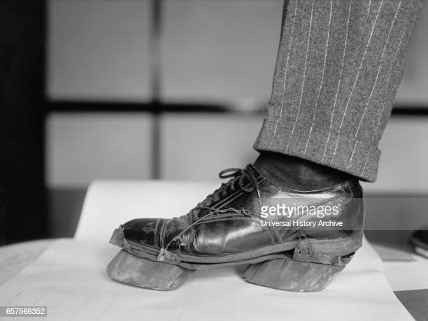 Policeman Trying on Cow Shoe used by Moonshiners during Prohibition Washington DC USA National Photo Company June 1924
