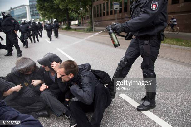 Policeman use pepper gas during quotBlock G20 Colour the Red Zonequot demonstration during G 20 summit in Hamburg on July 7 2017