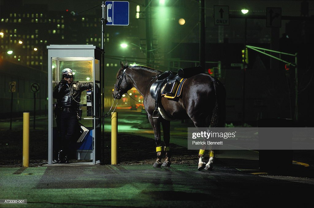 Policeman Using Telephone Booth Horse Tied Up Nearby Night Usa High Res Stock Photo Getty Images
