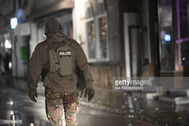 A policeman walks near a house thought to be the home of the man who drove his car into a carnival procession on February 24 2020 in Volkmarsen near...