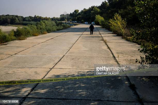 A policeman walks on October 9 near the site where Bulgarian television journalist Viktoria Marinova was killed on October 6 in the city of Rousse...