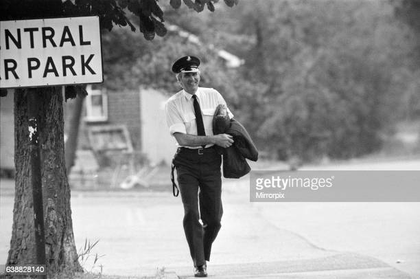 A Policeman watches as Michael Peterson stages a protest on the roof of Broadmoor Hospital 20th June 1983