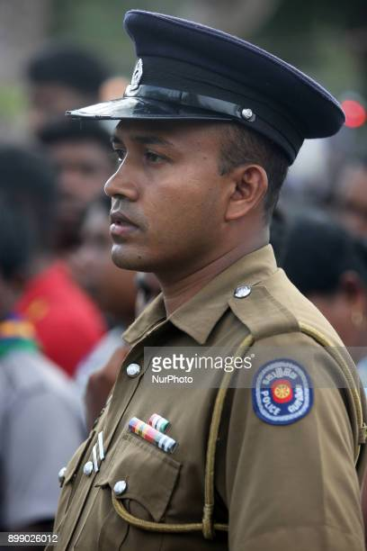 Policeman watches over the massive crowd of pilgrims at the Shrine of Our Lady of Madhu during the Feast of Our Lady of Madhu in Mannar Sri Lanka...