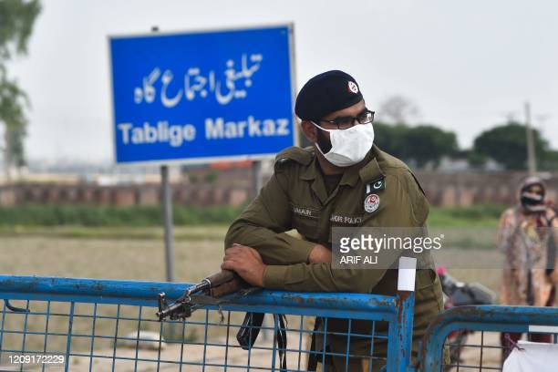 Policeman wearing a facemask stands at the Tablighi Markaz checkpoint during a government-imposed nationwide lockdown as a preventive measure against...